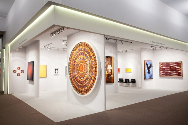 Figure 3. Stand of Sperone Westwater gallery. In the forefront is Damien Hirst's mandala-like composition of butterfly wings.