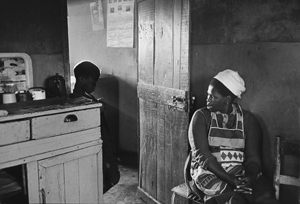 """Ernest Cole, """"Township mother fights losing battle to keep son, age nine, from running off to live life of the streets. She tries to assert authority with threats: 'What's your future going to be like without an education?' But it is too late; the boy - called Papa - is out of control."""" - House of Bondage, 1967. Silver gelatin print, 7 7/8 x 11 3/8 in. © The Ernest Cole Family Trust. Image courtesy the Hasselblad Foundation."""