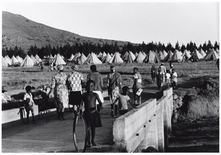 "Ernest Cole, ""Community of two thousand people, uprooted before new township was ready for them, was moved into tent city, instead."" Caption to a similar picture in House of Bondage, date unknown. Gelatin silver print, 8 5/8 x 12 5/8 in. © The Ernest Cole Family Trust. Image courtesy the Hasselblad Foundation."