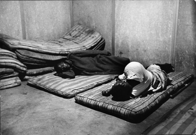 Ernest Cole, no known caption (According to other captions in House of Bondage hospitals for blacks were usually overcrowded. People sometimes had to lie on mattresses wherever there was an empty spot. According to Alf Kumalo this was probably on the veranda of the Baragwanath Hospital in Soweto.), date unknown. Gelatin silver print, 6 7/10 x 9 2/5 in. © The Ernest Cole Family Trust. Image courtesy the Hasselblad Foundation.