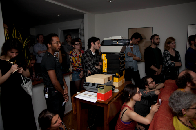 Samuel Budin with the slide projector at Room & Board, photo E.T. Miller