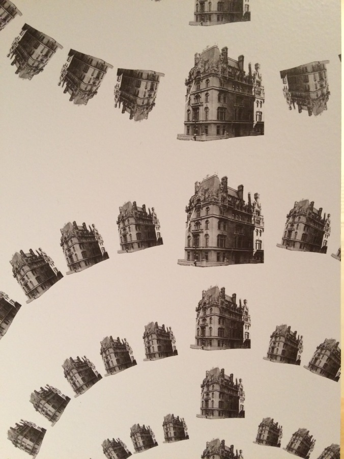 Wallpaper in Repetition and Difference showing representations of the Jewish Museum taken at different points in its history. Photograph by the author.